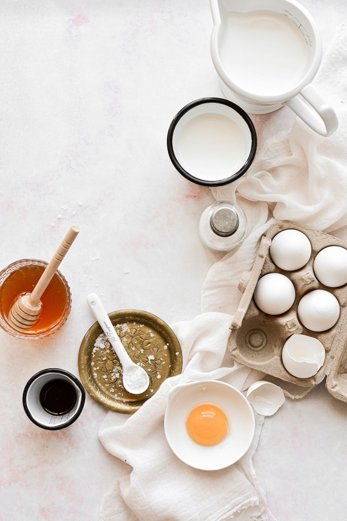 Ingredients for salted honey ice cream arranged in an overhead shot.