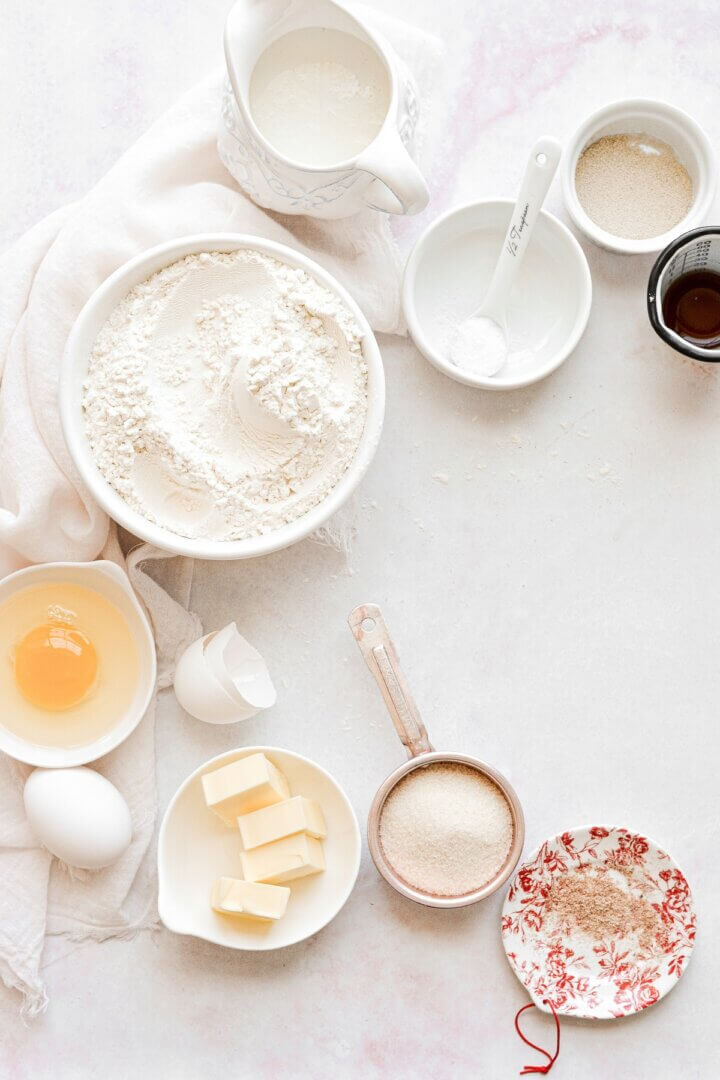 An arrangement of ingredients for making dough for strawberry rolls.