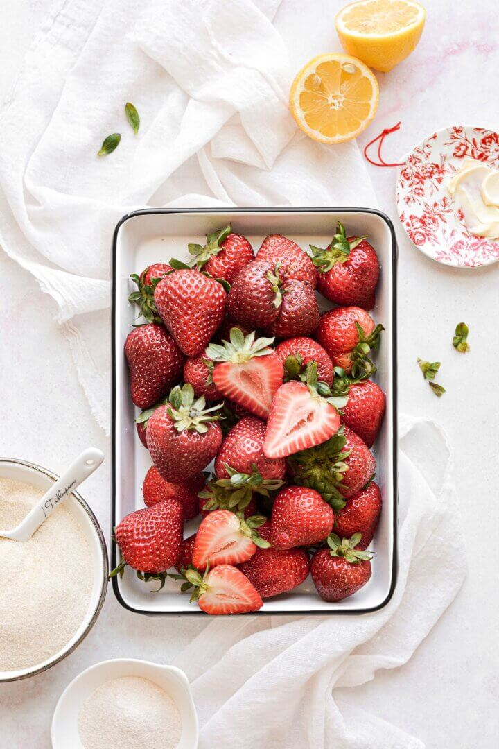 Fresh strawberries in a metal tray.