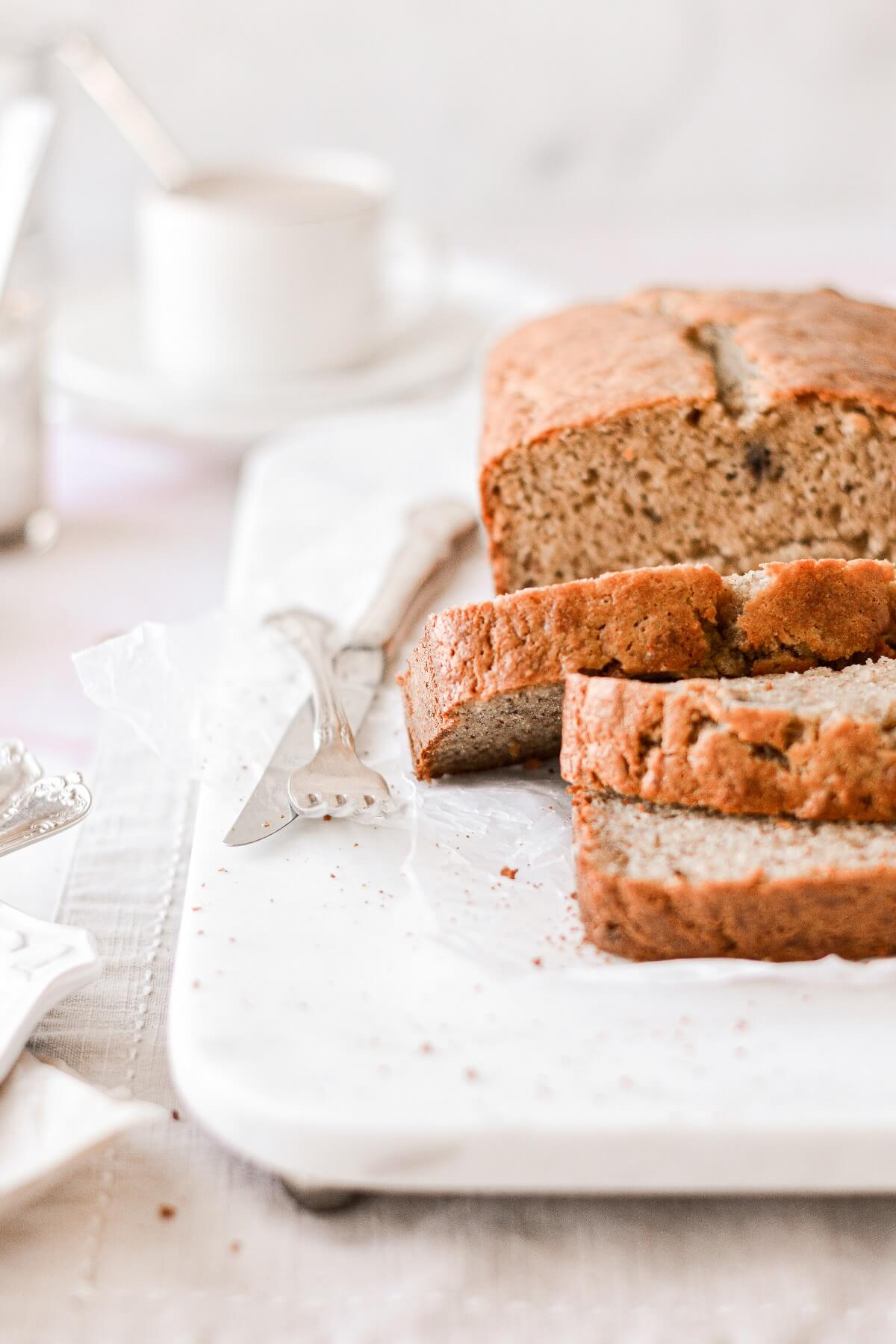A loaf of banana bread cut into slices.