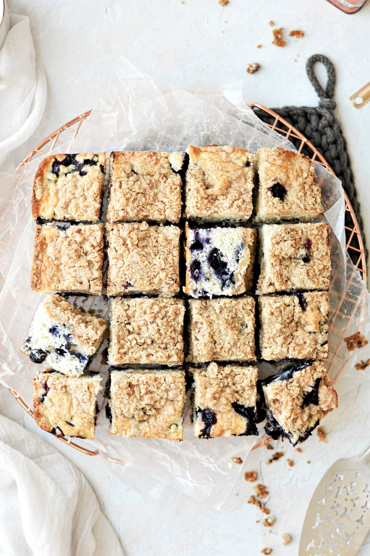 Blueberry buckle coffee cake cut into squares.