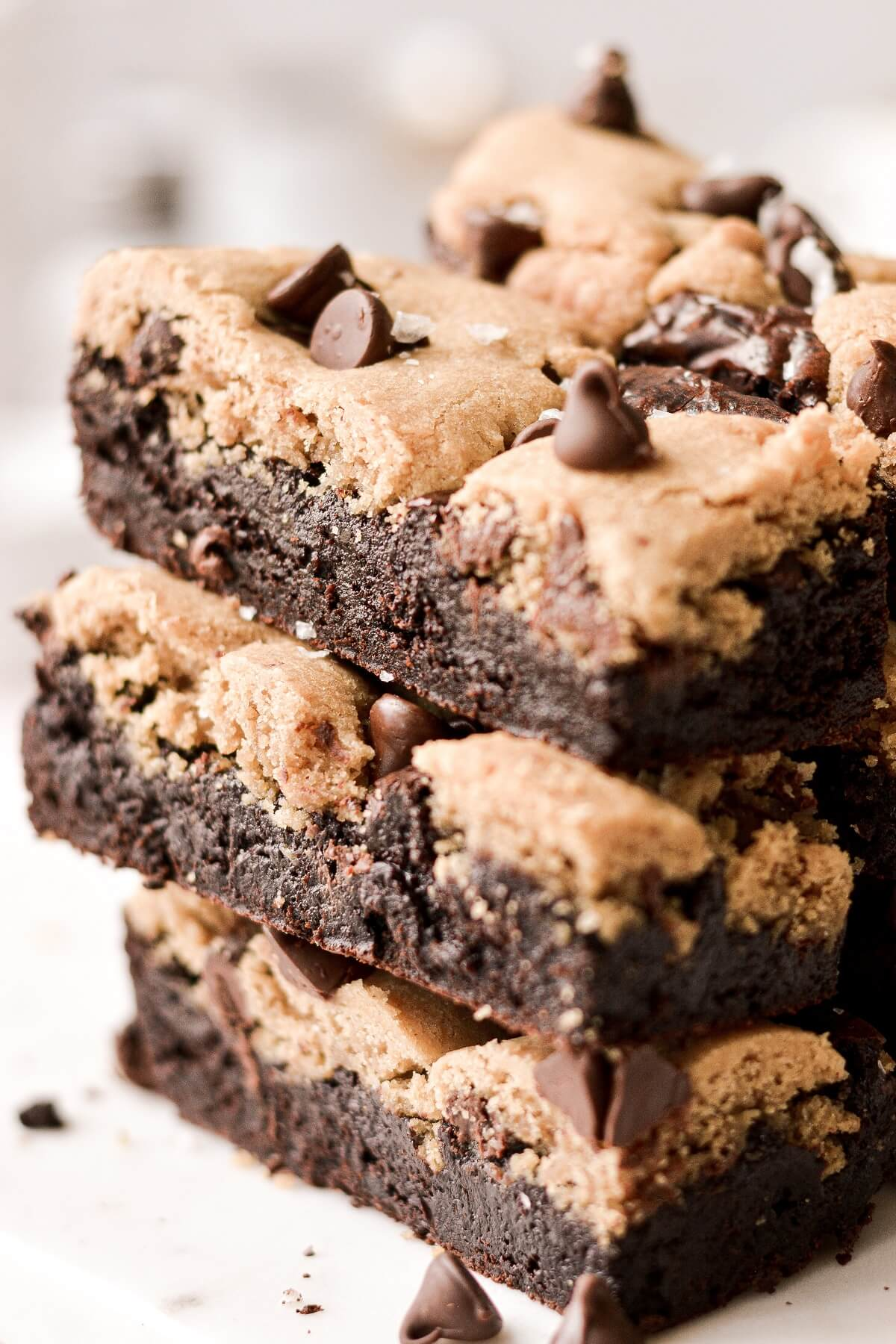 A stack of chocolate chip cookie brownies.