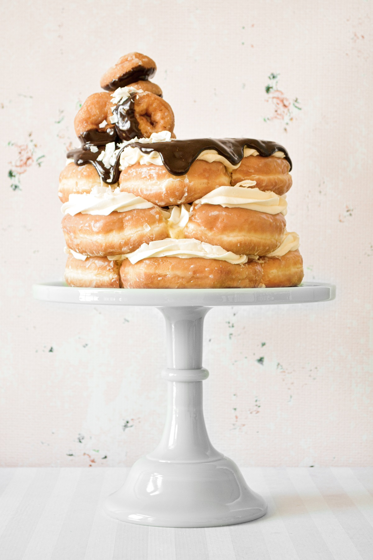 Doughnut cake, filled with custard and buttercream, and topped with chocolate ganache.