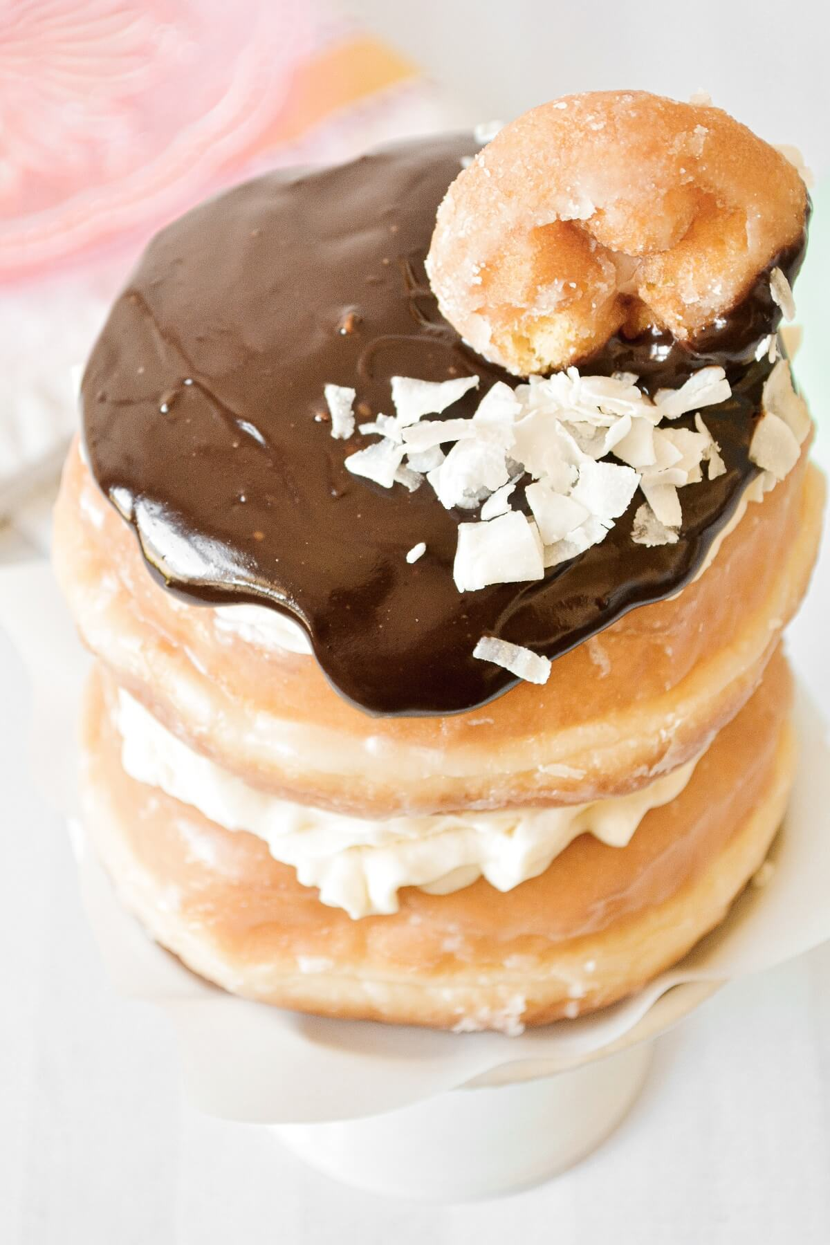 Doughnut cake, filled with custard, and topped with chocolate ganache.