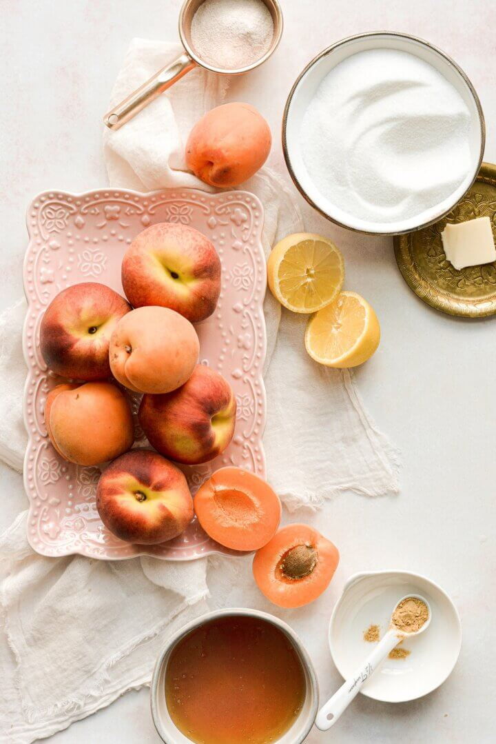 Ingredients for making peach apricot jam with ginger and honey.