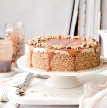 A no bake peanut butter cheesecake, topped with peanut butter maple caramel sauce and peanuts.