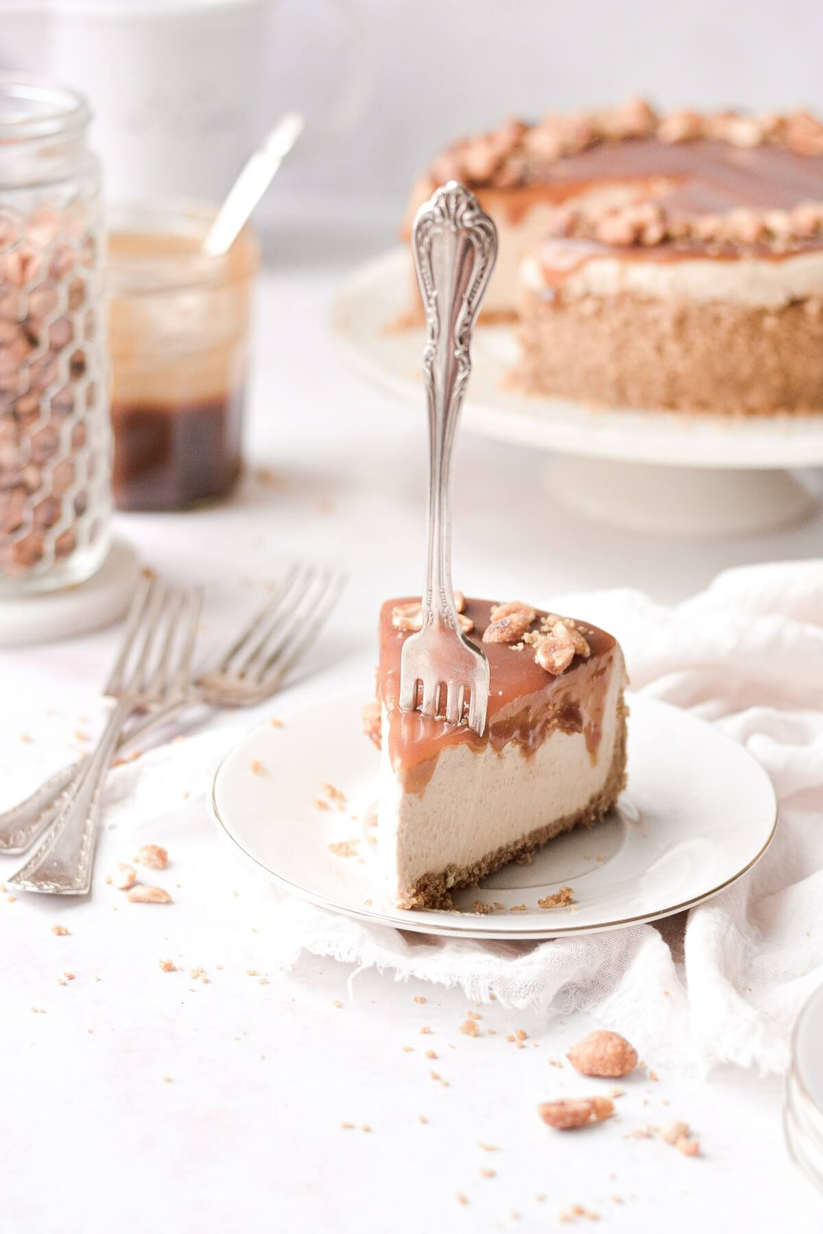 A slice of peanut butter cheesecake with a fork stuck in.