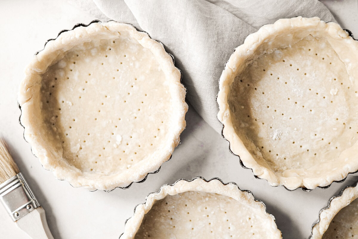 Pie dough in mini tart pans.