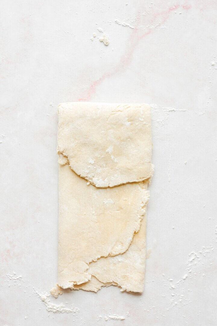 The process of folding pie dough.
