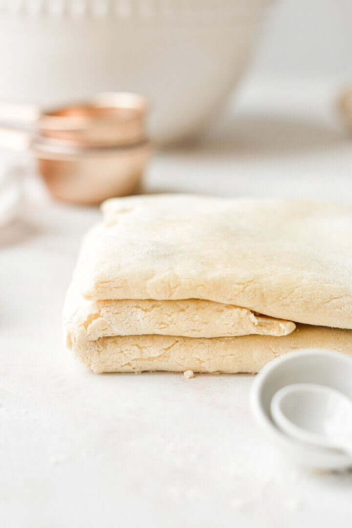 Pie dough, folded up into layers.