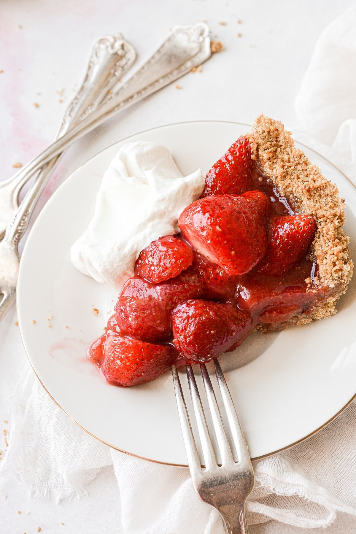 A slice of strawberry pretzel pie with whipped cream.