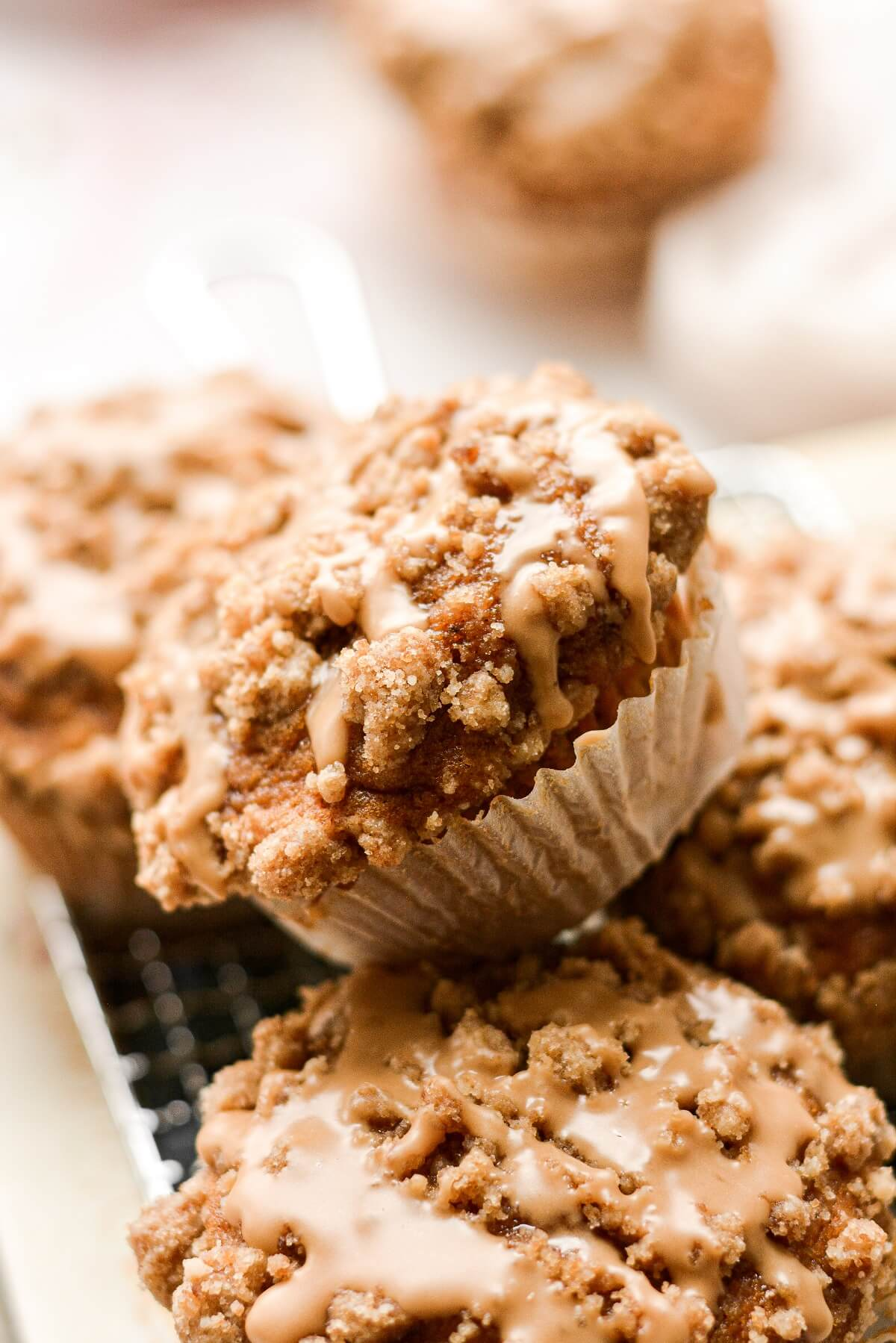 Closeup of sweet potato crumb muffins drizzled with maple icing.