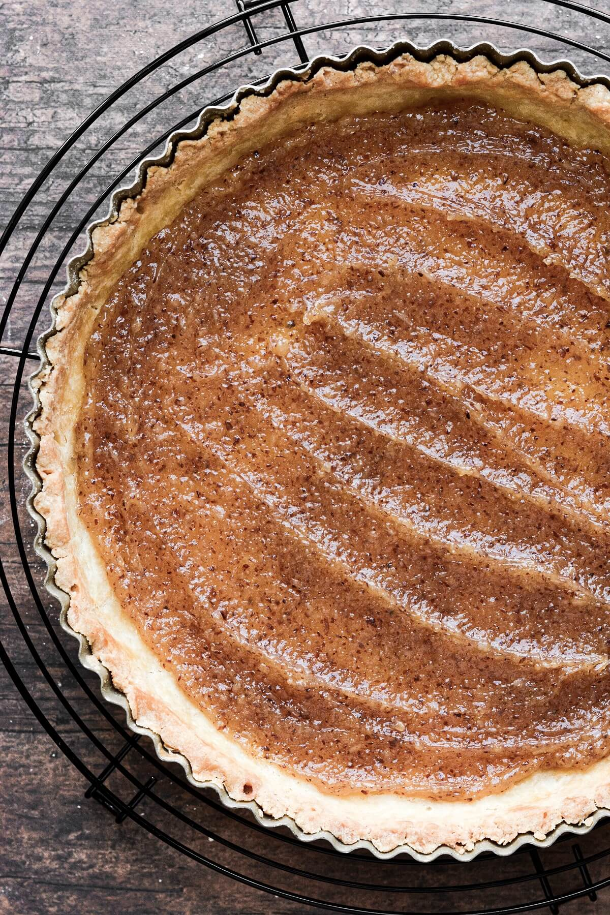 A shortbread tart crust filled with almond pastry filling.