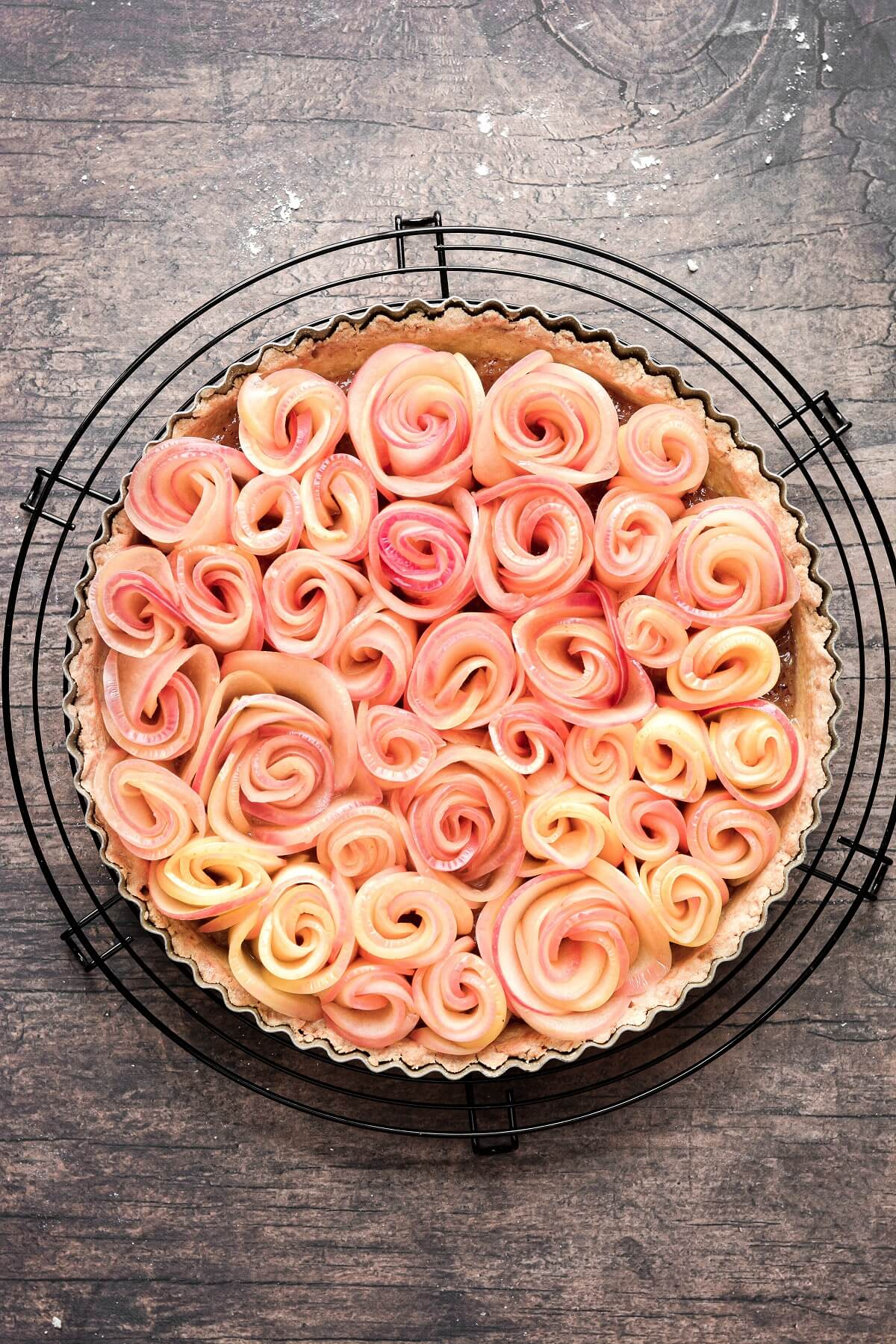 An apple rose tart ready to be baked.