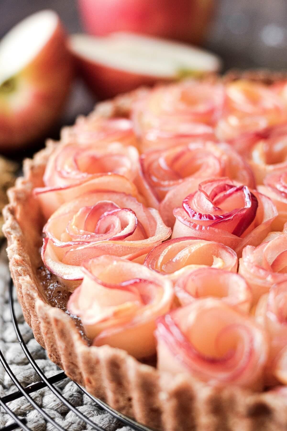 Closeup of apple roses in a tart crust.