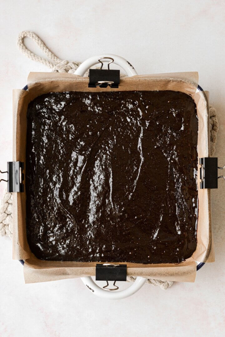 Unbaked brownie batter in a baking dish.
