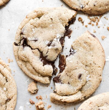 A chocolate chip cookie broken in half.