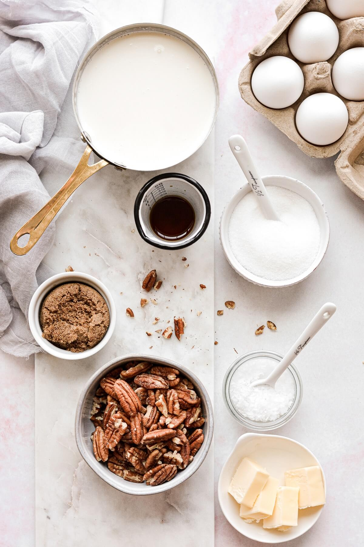 Ingredients for homemade butter pecan ice cream.