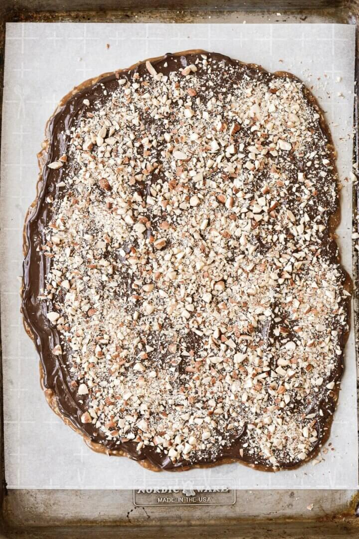 English toffee with chocolate and chopped almonds, ready to be cut.