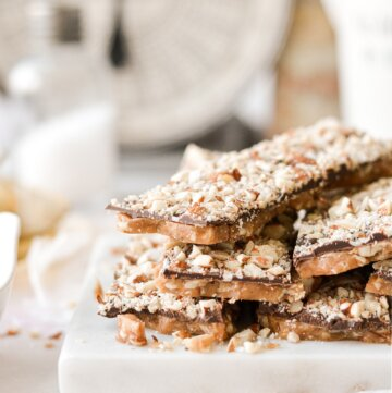Bars of English toffee stacked on a marble board.