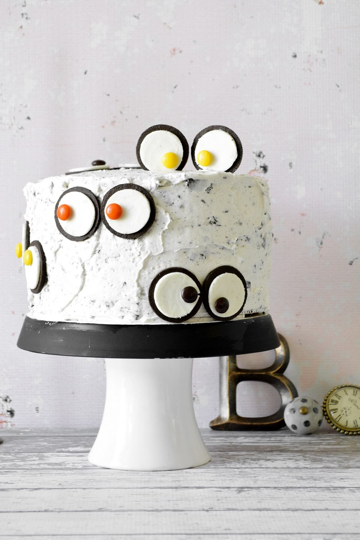 A Halloween cake with Oreo monster eyes.