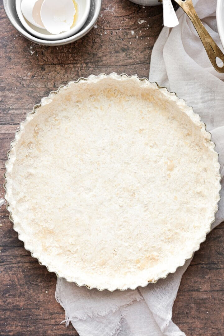 Shortbread tart crust ready to be baked.