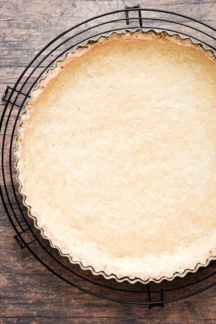 A baked shortbread tart crust.