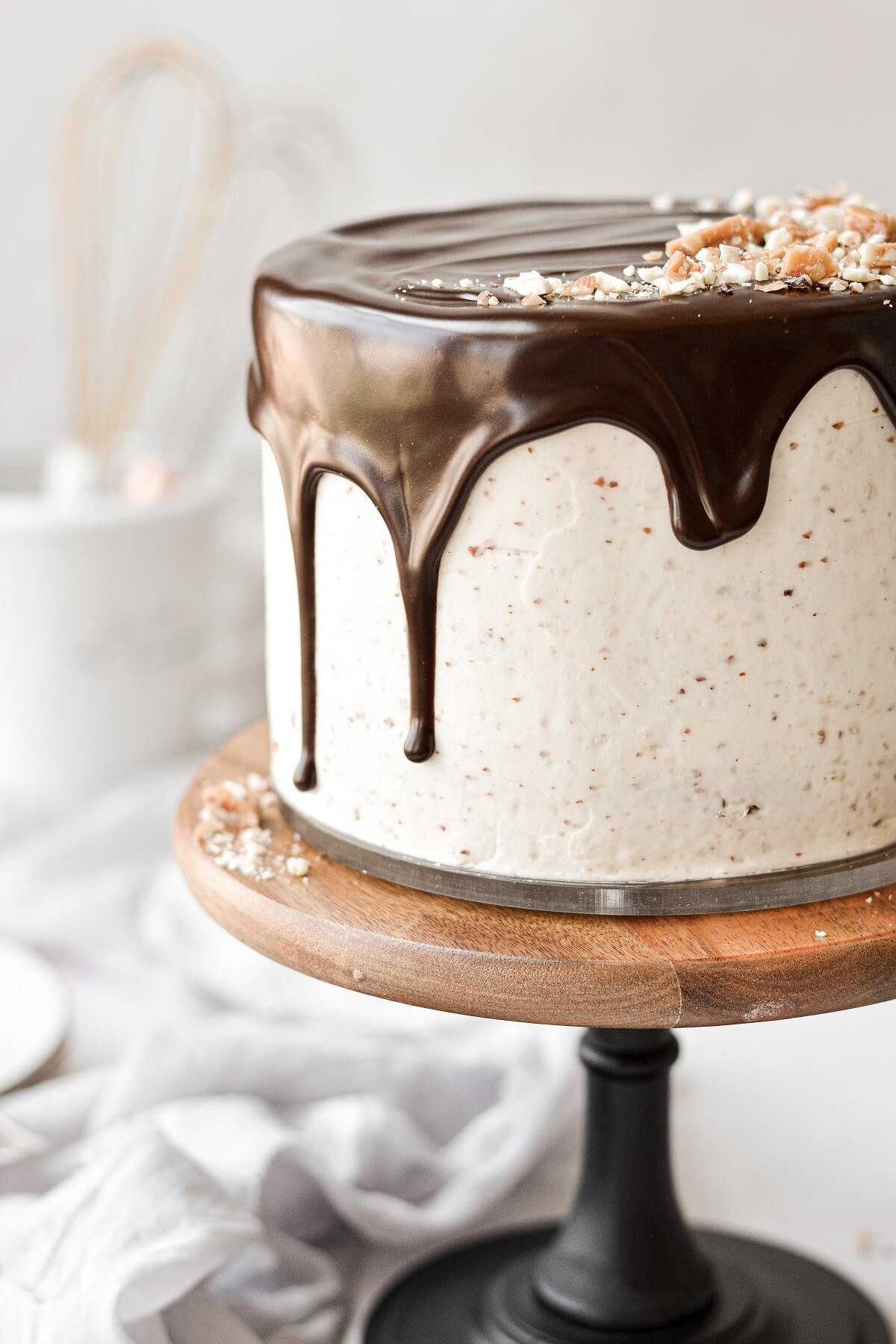 Closeup of ganache drip on a chocolate almond cake.