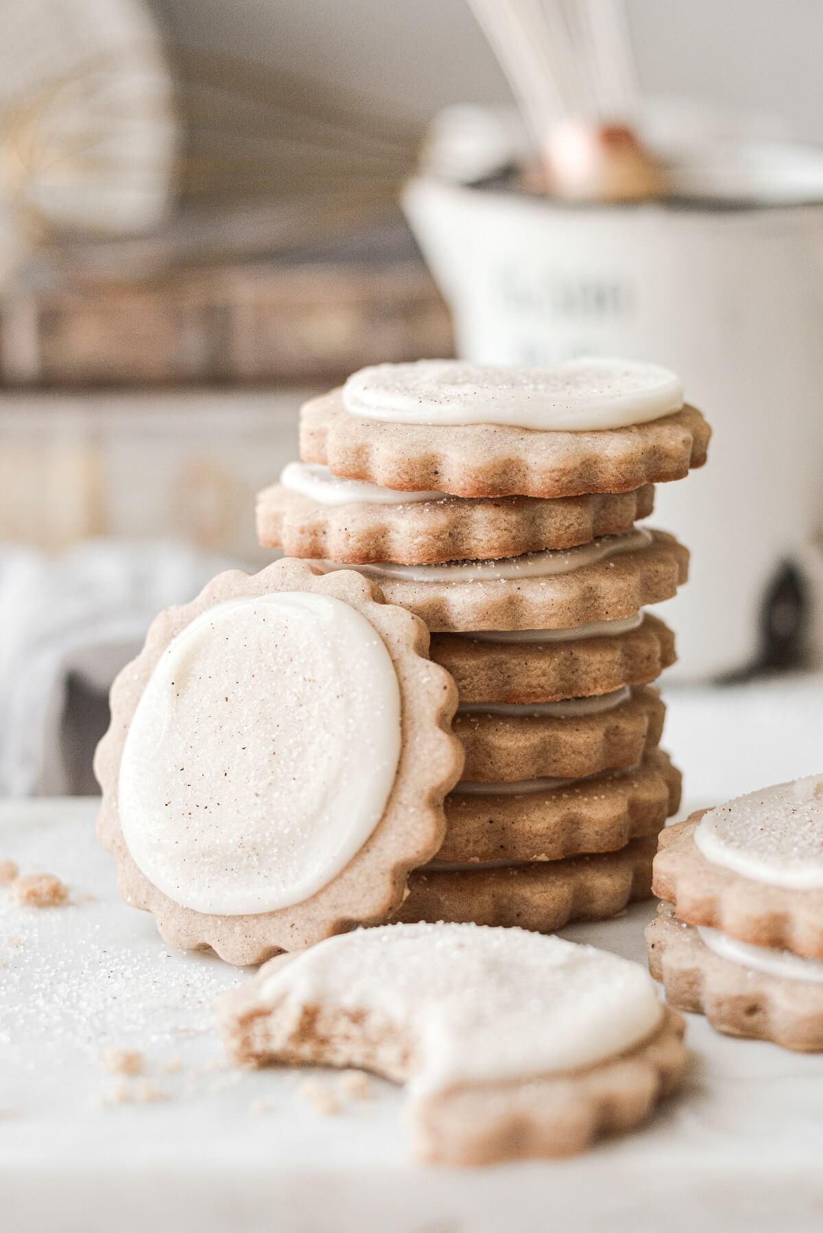 A stack of iced cinnamon sugar cookies.