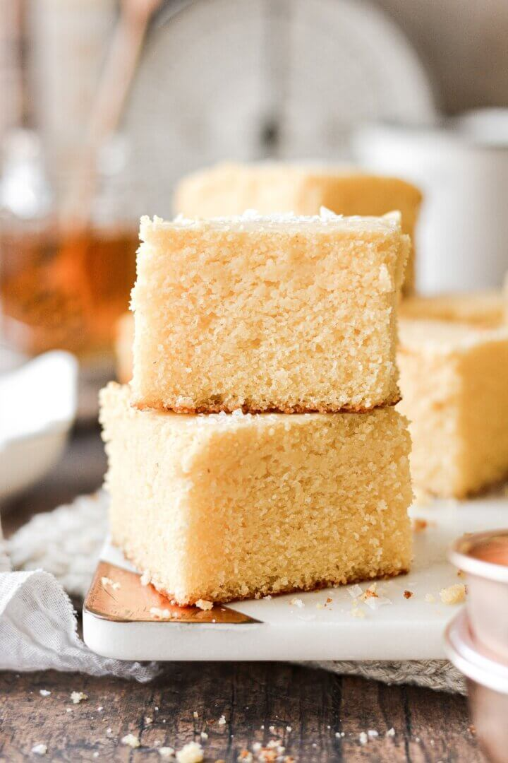 Two pieces of cornbread stacked on top of each other.