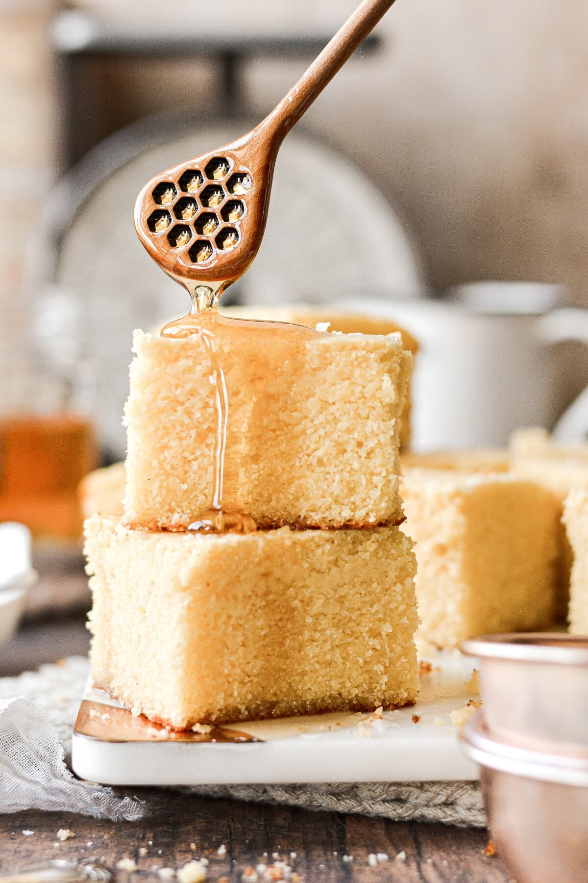 Honey drizzling over the top of cornbread.