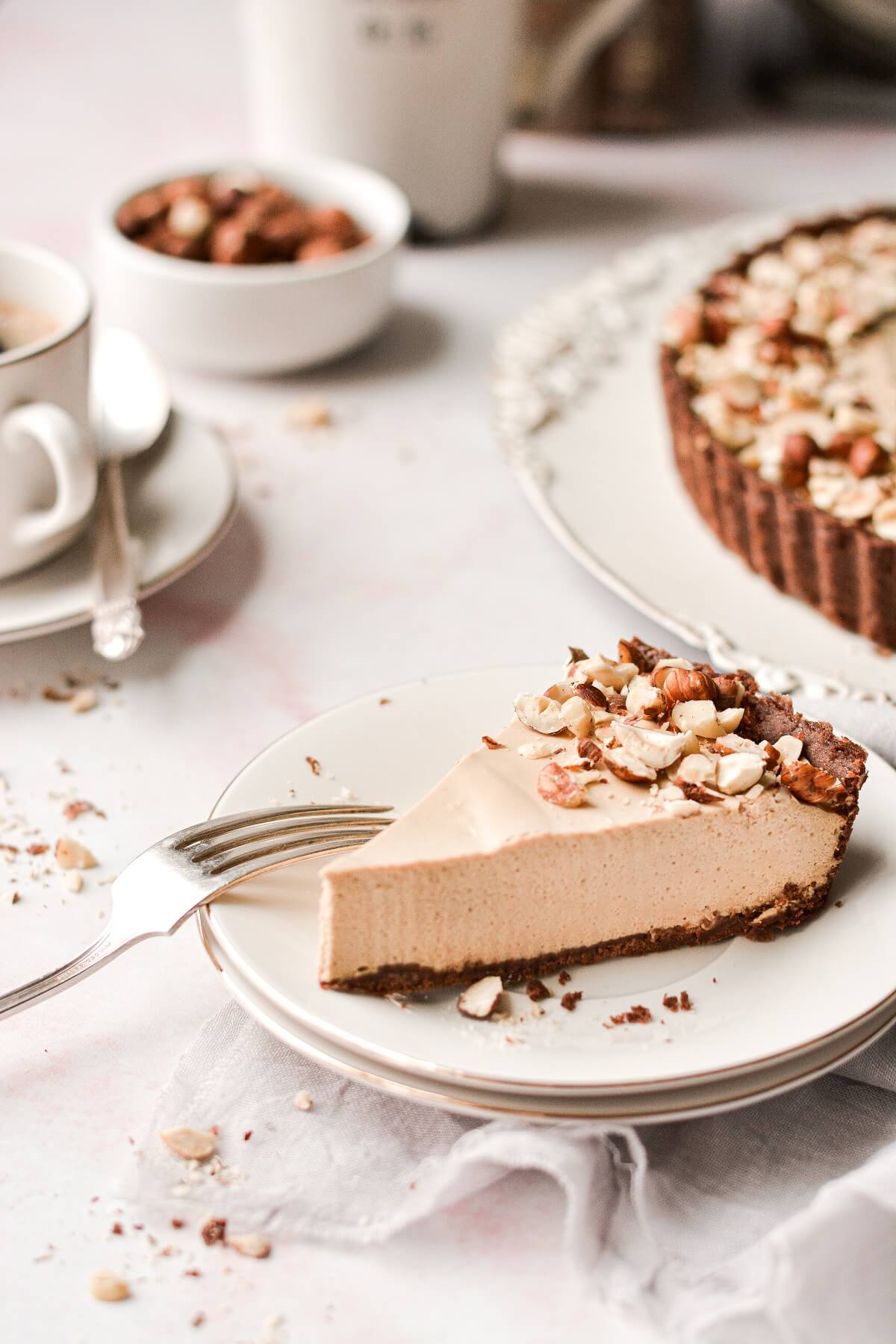 A slice of coffee cream tart on a white plate.