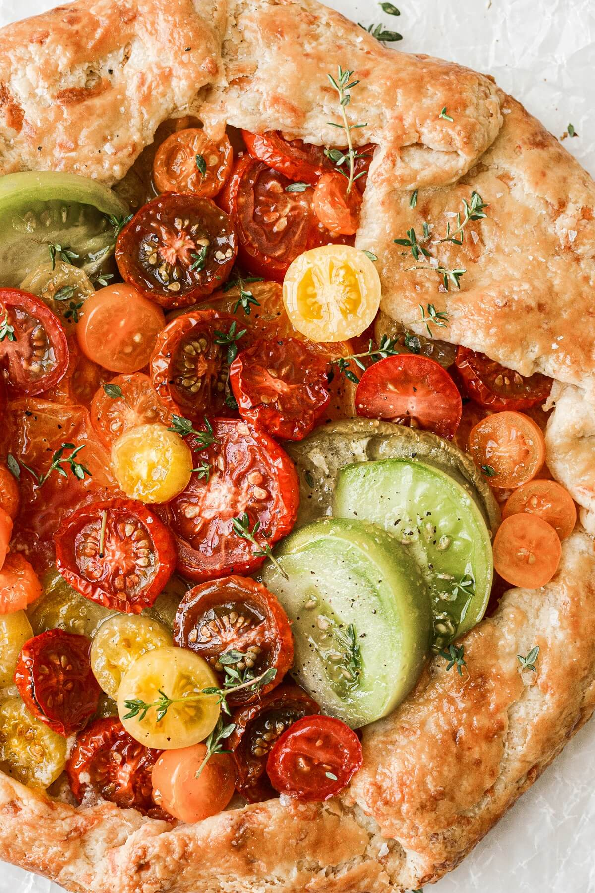 Closeup of heirloom tomatoes in a savory tomato galette.