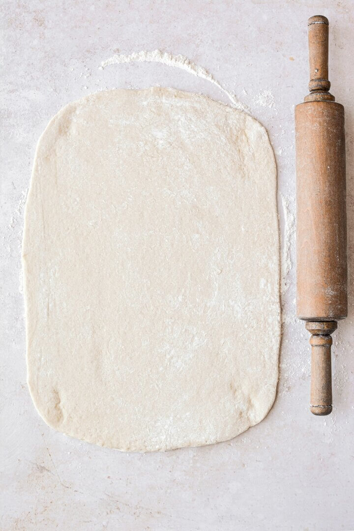 Dough rolled out into a rectangle.