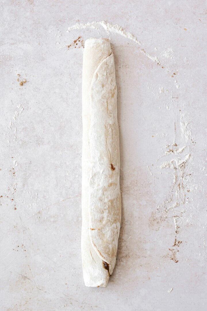 A log of cinnamon roll dough.