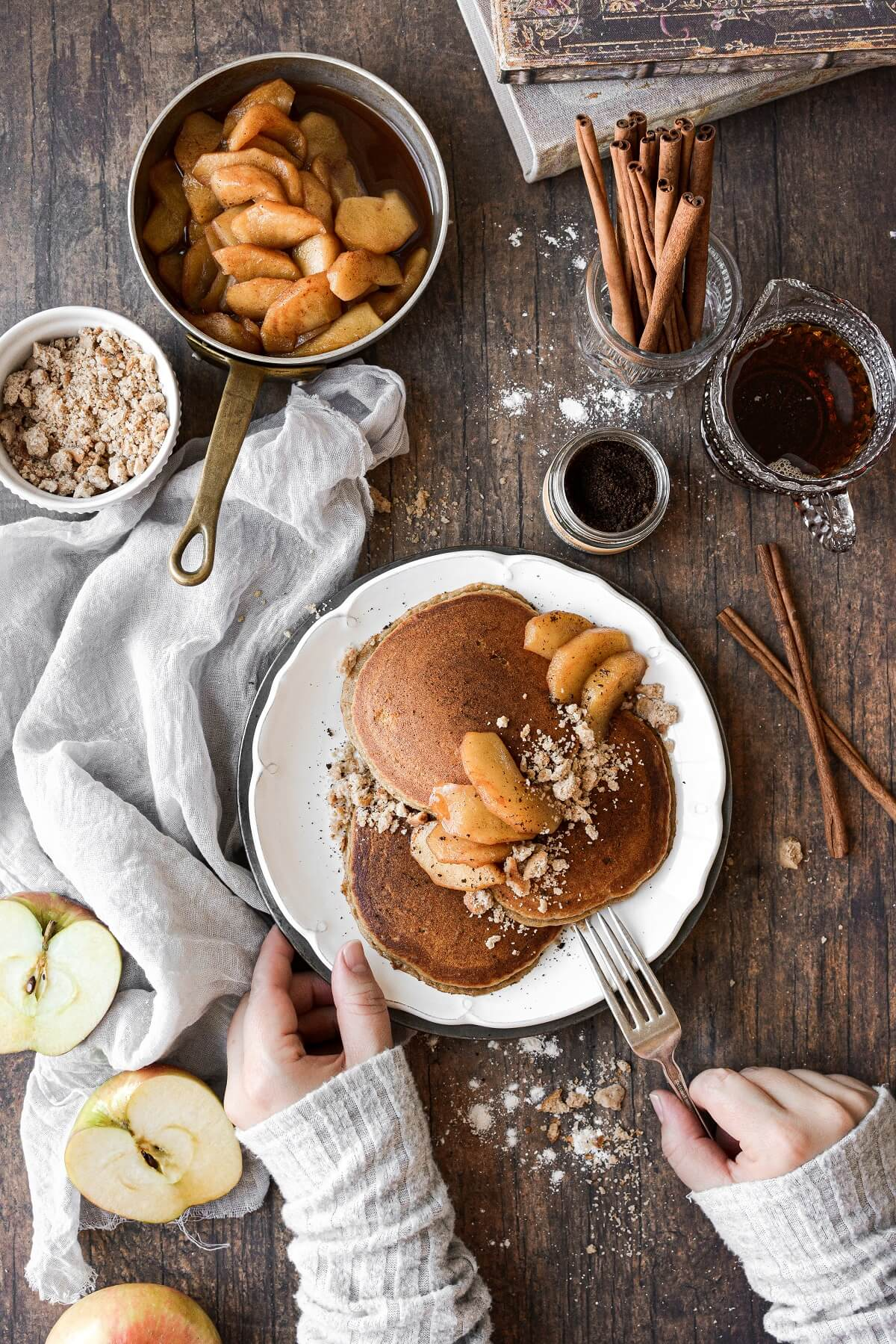 A plate of apple cider pancakes in a cozy fall scene.