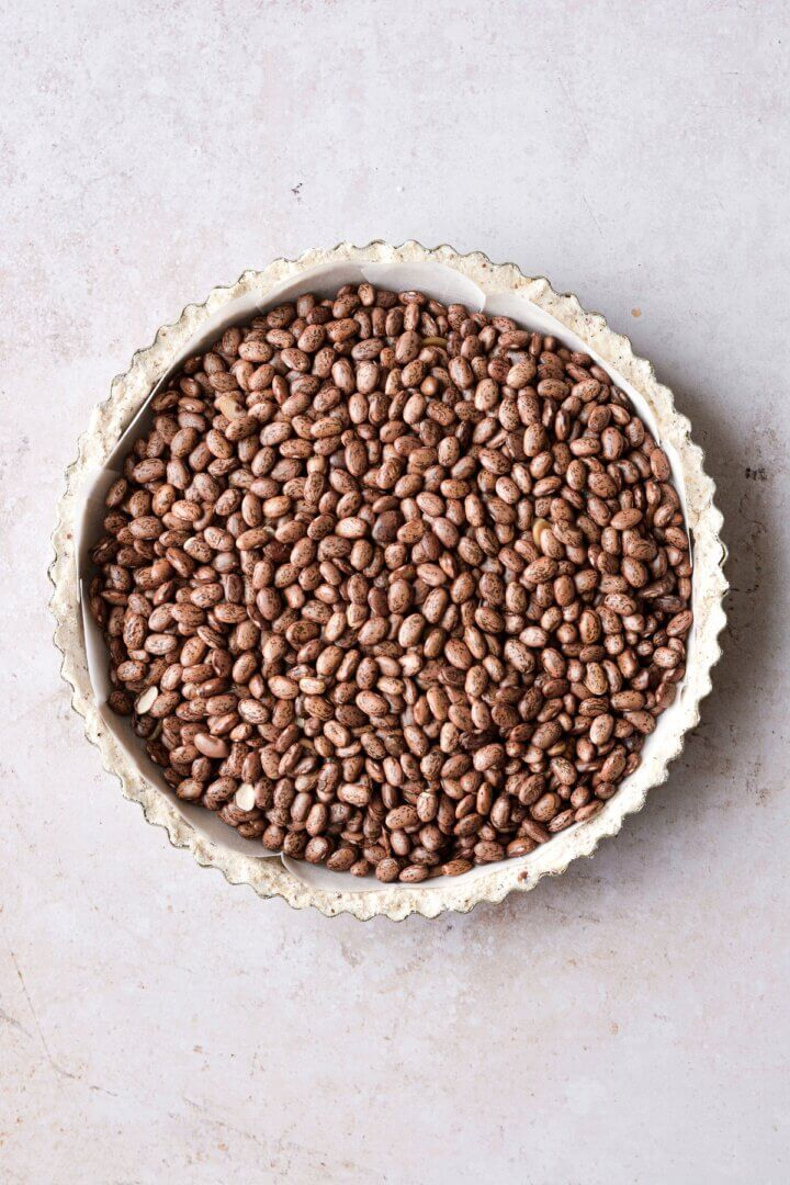 Shortbread crust filled with dried beans.